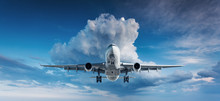 Beautiful Airplane. Landscape With White Passenger Airplane Is Flying In The Blue Sky With Clouds At Overcast Day. Travel Background. Passenger Airliner. Business Trip. Commercial Plane. Aircraft