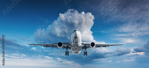 Poster Avion à Moteur Beautiful airplane. Landscape with white passenger airplane is flying in the blue sky with clouds at overcast day. Travel background. Passenger airliner. Business trip. Commercial plane. Aircraft