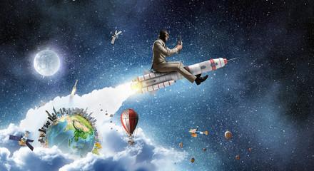 Aviator riding rocket. Mixe...