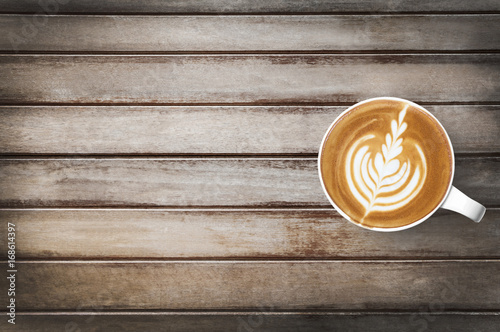 Cup of hot latte coffee us on top of wood table Tableau sur Toile