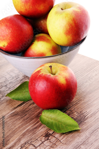 Tuinposter Bier / Cider Ripe red apples on wooden background summer concept