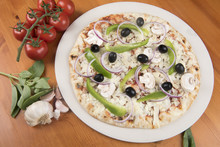 Uncooked Vegetarian Pizza With Olives, Peppers, Onion, Mushrooms And Basil