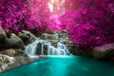 Fototapeta  - Beautiful colorful waterfall in autumn forest.