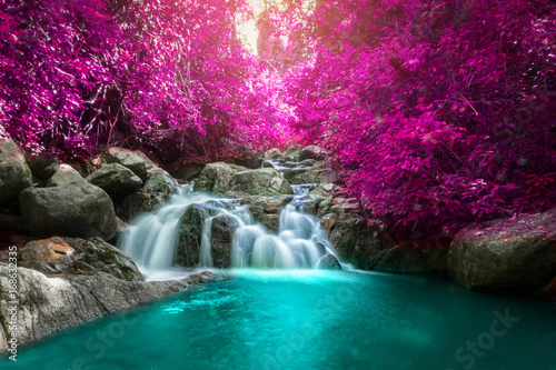 Tuinposter Watervallen Beautiful colorful waterfall in autumn forest.