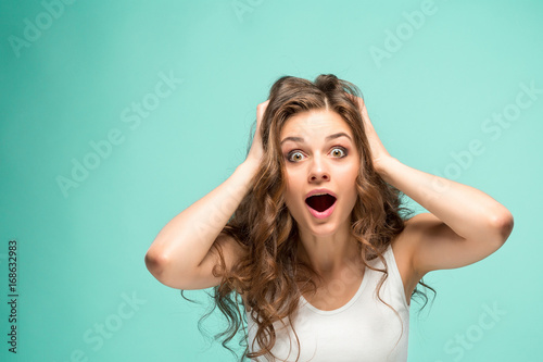 Portrait of young woman with shocked facial expression Canvas Print