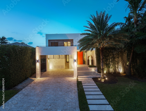 Exterior view of modern home at dusk