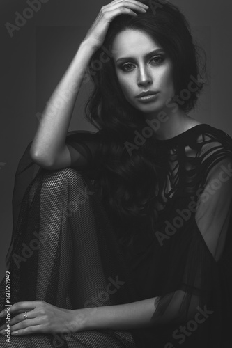 Fototapety, obrazy: Young slim girl in black sexy fashionable dress.