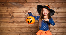 Funny Child Girl In Witch Costume In Halloween