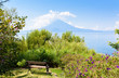 Paradise beach at lake Atitlan, Panajachel - Relaxing and recreation at beach with vulcano landscape scenery in the highlands of Guatemala
