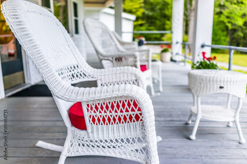 Front porch of house with white rocking chairs on wooden deck Canvas Print