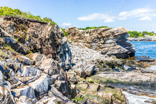 Cliff rocks side view by Portland Head Lighthouse in Fort Williams park in Cape Poster