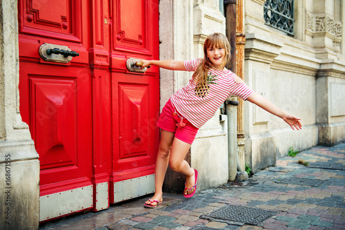 Adorable little girl tourist on the streets of Provence, travel with kids