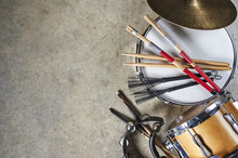 A Pile Of Drum Equipment