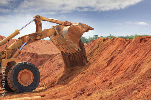 one bulldozer at Weipa bauxite mine Wallpaper Mural