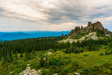 Fototapeta na wymiar Flying clouds over the rocks and mountain range