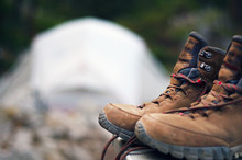 Hiking Boots In Focus With Tent