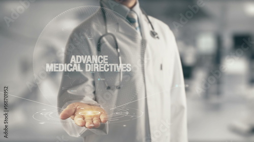 Doctor holding in hand Advance Medical Directives Wallpaper Mural