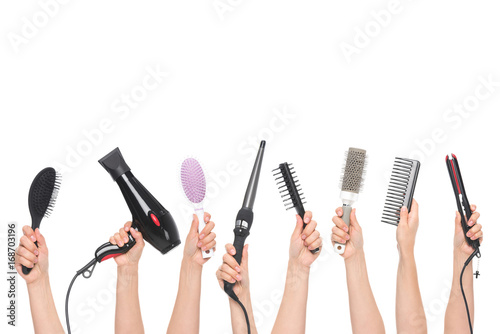Photo hands holding hairdressing tools