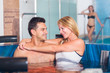 Romantic couple is talking while relaxing together