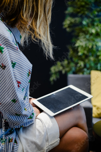 Deurstickers Ontspanning Business person using holding digital tablet mobile pc device over blurred background. Close up technology concept