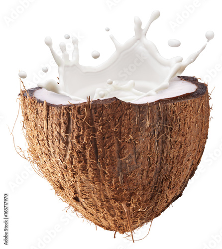 Coconut fruit and milk splash inside it. Clipping path.