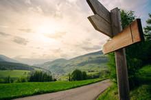 Empty Wooden Arrow Sign Near Mountains Landscape