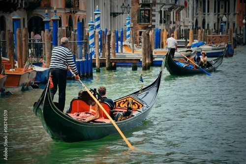 Gondola in canal in Venice фототапет