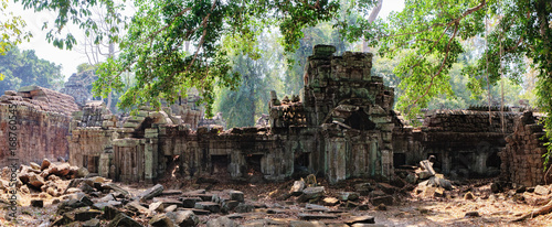 Recess Fitting Ruins Od ruins of Preah Khan Temple in Siem Reap, Cambodia. Preah Khan has been left largely unrestored, with trees and other vegetation growing among the ruins.