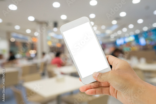 Keuken foto achterwand New York smart phone with abstract blur of food court background