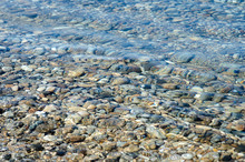 Pebble Stones Into The Water I...