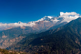 Fototapeta Do pokoju - View of Fish Tail mountain or also know as Machapuchare in the Annapurna Himalayas of north central Nepal. It is revered by the local population as particularly sacred to the god Shiva.