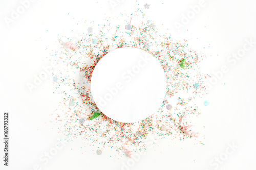 Obraz Creative round layout with copy space made of colorful confetti on white background. Celebration concept background. Flat lay, top view. - fototapety do salonu
