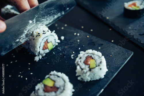 Fotografie, Obraz  Sushi Being Cut