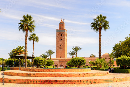 Photo Stands Morocco Minaret of the Koutoubia Mosque of Marrakesh, Morocco. It is the capital city of the mid-southwestern region of Marrakesh-Asfi.