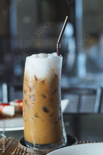 Foto op Aluminium Milkshake Iced latte and topping with whipped cream served in the glass .