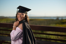 Young Lady In Cap And Gown Rea...