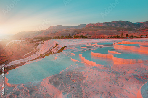 Photo Stands Candy pink Natural travertine pools and terraces in Pamukkale. Cotton castle in southwestern Turkey