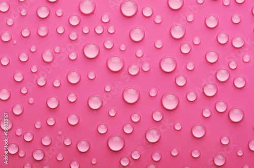 water drops on a pink background - 168833167