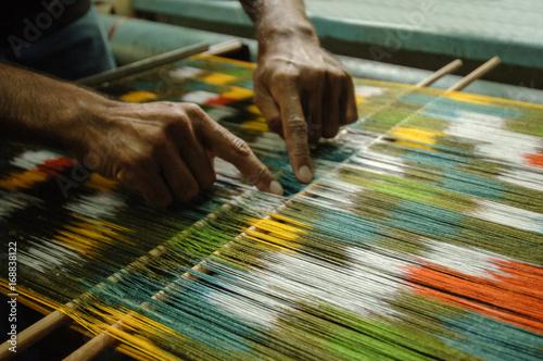 Fotografie, Obraz  weaving and manufacturing of handmade carpets closeup
