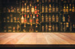 canvas print picture - Empty the top of wooden table with blurred counter bar and bottles Background