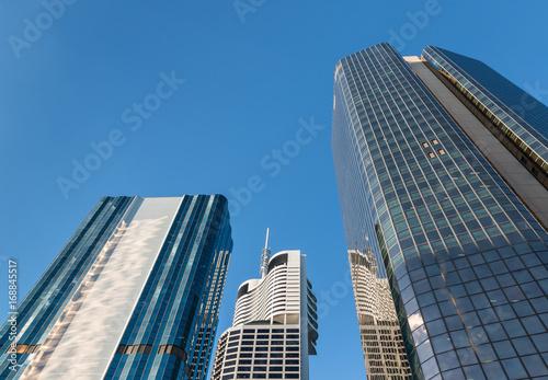 In de dag Milan modern skyscrapers in Brisbane CBD against blue sky with copy space