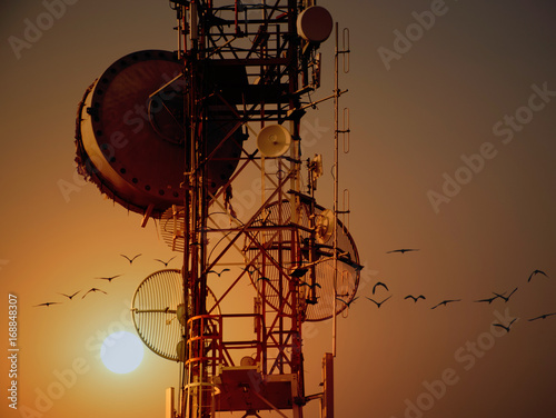 Fotografie, Tablou  Telecommunication tower Antennas with sunset