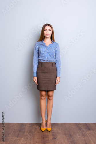 Full length portrait of serious young business lady in strict formal wear standi Tablou Canvas