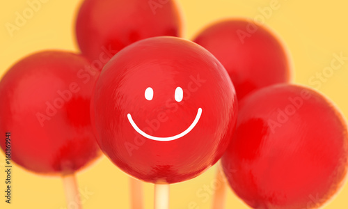 Fototapeta  Red balls of lollipops on stick vase with hand drawn smile face in red vase