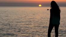 Girl Waiting Boat At Sea At Su...