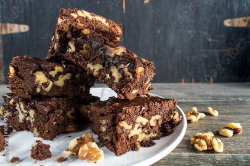 walnut brownies stacked on plate closeup