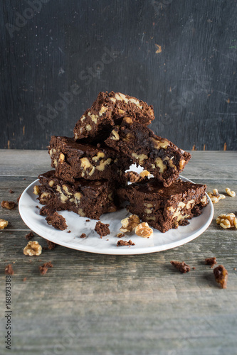 walnut brownies stacked on plate