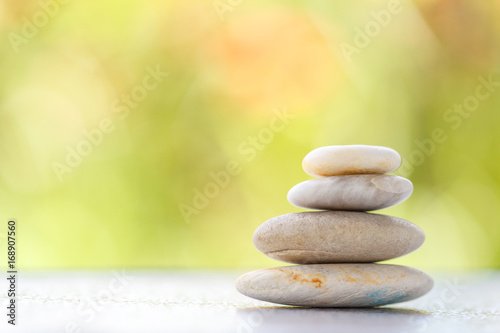 Photo sur Plexiglas Zen pierres a sable Stones pyramid symbolizing stability, zen ,Zen spa concept , Zen Massage Stone against green bokeh background
