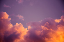 Magnificent Colorful Clouds In The Evening Sky. Bright, Pink Clouds In The Sky At Sunset. Beautiful Evening Skyscape. Abstract, Purple Pink Background. Vibrant Color Photograph.