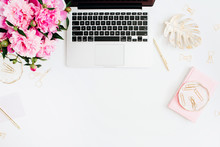 Flat Lay Home Office Desk. Female Workspace With Laptop, Pink Peonies Bouquet, Golden Accessories, Pink Diary On White Background. Top View Feminine Background.